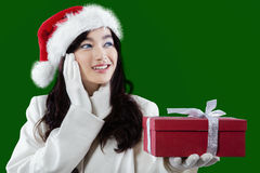 Lovely girl with christmas gift Royalty Free Stock Images