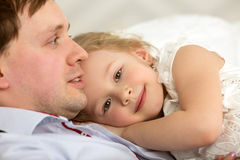 Lovely girl close to beloved father Stock Photo