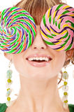 Lovely girl closes eyes two lolipops Stock Photo