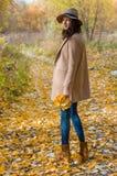 Lovely girl in the coat looks ahead Stock Photo