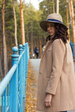 Lovely girl in the coat looks ahead Stock Photography