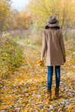 Lovely girl in the coat looks ahead Stock Photos