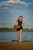 Lovely girl coming out of the water. royalty free stock images