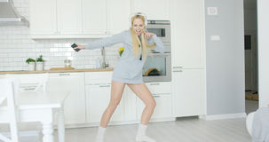 Lovely girl dancing at home Stock Image