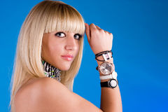 Lovely girl with different clocks on hand Royalty Free Stock Photography