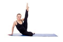 Lovely girl doing fitness exercises on mat Stock Photo