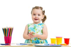 Lovely girl drawing with colorful pencils Stock Photography