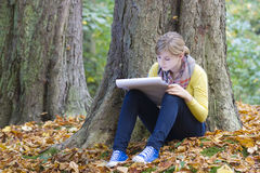 Lovely girl drawing in the park Stock Images