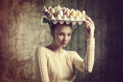 Lovely girl with easter eggs box Royalty Free Stock Photo