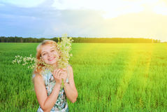 Lovely girl enjoying the sun on green grass Royalty Free Stock Photo