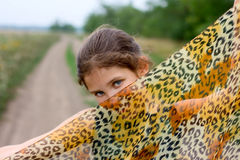 Lovely girl with fabric on road Royalty Free Stock Image