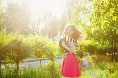 Lovely girl with flying hair holds hat in her hands Royalty Free Stock Photo