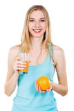 Lovely girl with fresh orange and juice Royalty Free Stock Images