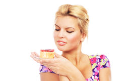 Lovely girl with a fruit cake Royalty Free Stock Image