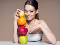 Lovely girl with fruits mix, natural organic raw fresh food concept Stock Image