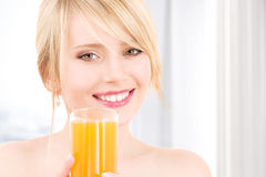 Lovely girl with glass of juice Royalty Free Stock Photos