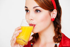 Lovely girl with glass of orange juice Stock Image