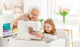 Lovely girl with granny sewing