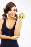 Lovely girl with a green apple Royalty Free Stock Image