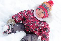 Lovely girl has a fun in snow Stock Images