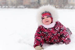 Lovely girl has a fun in snow Royalty Free Stock Photography