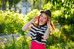 Lovely girl in a hat stock images