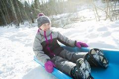 Lovely girl having fun on ancient sledge on winter Stock Photos