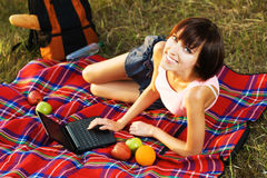 Lovely girl having a rest with laptop Stock Photo