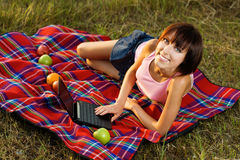 Lovely girl having a rest outdoors Stock Photography