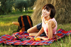 Lovely girl having a rest in the park Stock Images