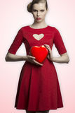 Lovely girl with heart shaped box Stock Photography