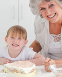 Lovely girl and her grandmother in a kitchen Royalty Free Stock Images