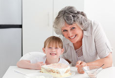 Lovely girl and her grandmother  in a kitchen Stock Photo