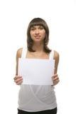 Lovely girl hold a sheet of paper. Lovely girl holding blank sign board over white Stock Photos