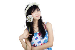 Lovely girl holding flower Royalty Free Stock Photography