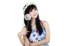 Lovely girl holding flower royalty free stock photography