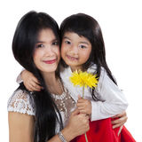 Lovely girl holding flower with her mom Royalty Free Stock Images