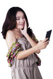 Lovely girl holding a mobile phone Royalty Free Stock Photos