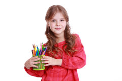 Lovely girl holding pencils Stock Images
