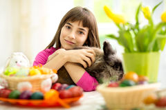Lovely girl hugging bunny Stock Photography