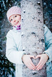 Lovely Girl Hugging a Tree in Forest Royalty Free Stock Images