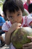 Lovely girl inhaling coconut milk Royalty Free Stock Photo