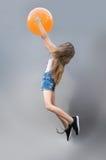 Lovely girl joyfully jumping Royalty Free Stock Images