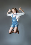 Lovely girl joyfully jumping Stock Photos