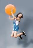 Lovely girl joyfully jumping Stock Images