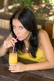 Lovely girl with juice Stock Photos