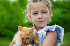 Lovely girl with a kitten in her arms Royalty Free Stock Photo