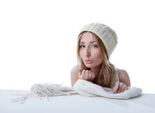Lovely girl in knitted hat sending air kiss Stock Photography