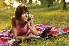 Lovely girl with laptop on picnic Stock Image