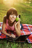Lovely girl with laptop on picnic Royalty Free Stock Photography